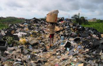 A boy hauls e-waste in Lagos, Nigeria