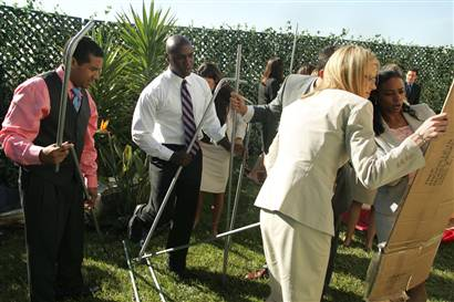 The Apprentice cast putting up a tent