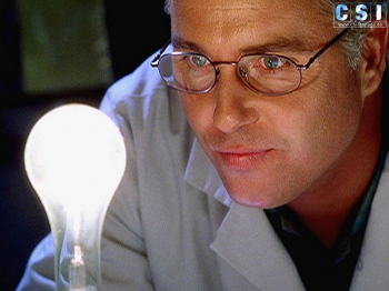 Grissom gazes into a lightbulb