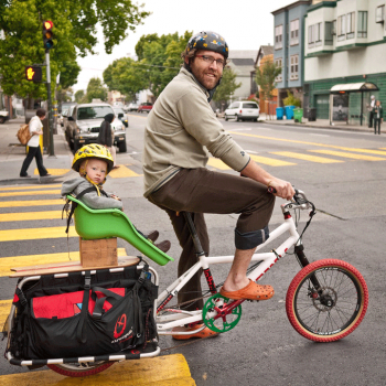 San Francisco father and child commuting by bicycle