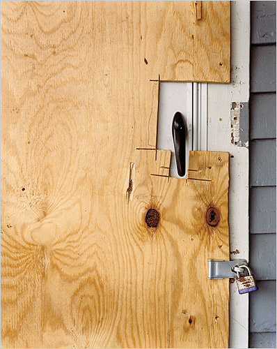 Boarded door of a foreclosed house