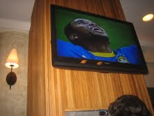 Television on the wall of a bar during the World Cup 2010