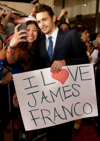 James Franco Stands With a Fan