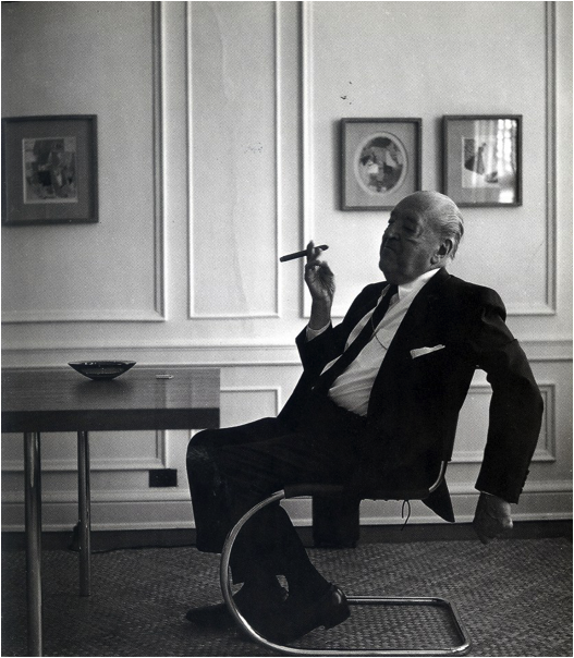 Architect Mies van der Rohe smoking a cigar