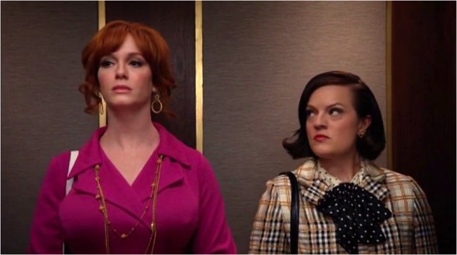 Peggy Olson and Joan Holloway ride the elevator up to Sterling Cooper's offices